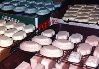 [Homemade Soaps Drying on Racks]